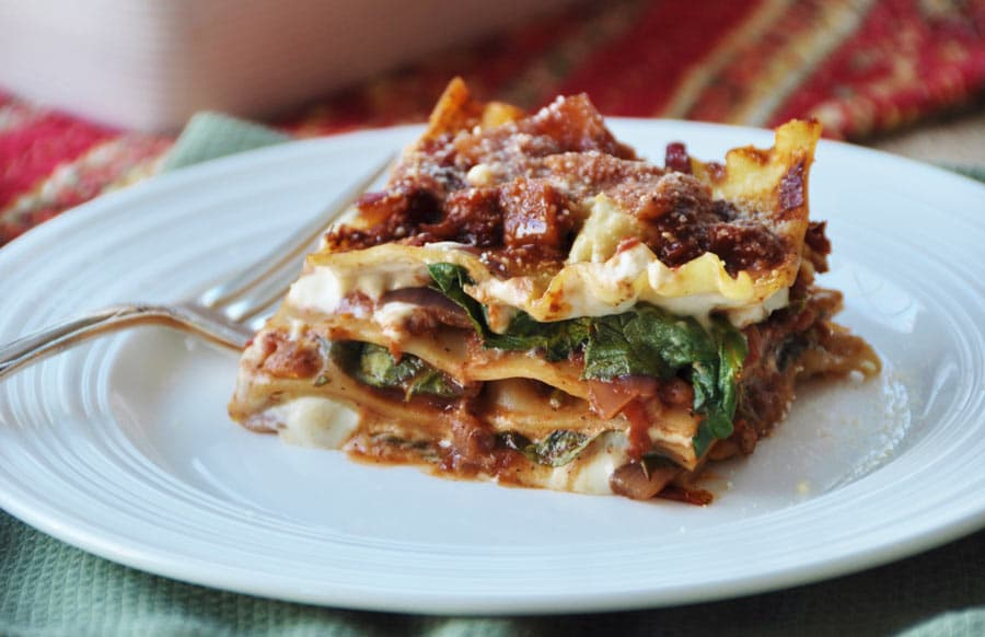 Vegan Spinach Lasagna! This is as good as my old conventional lasagna recipe, only this one is dairy-free! My family loves this vegan spinach lasagna, and you will too. www.veganosity.com