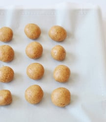 Peanut Butter balls on a piece of parchment paper.