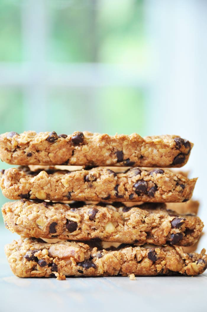 Vegan Peanut Butter Oatmeal Chocolate Chip Granola Bars stacked on a white surface