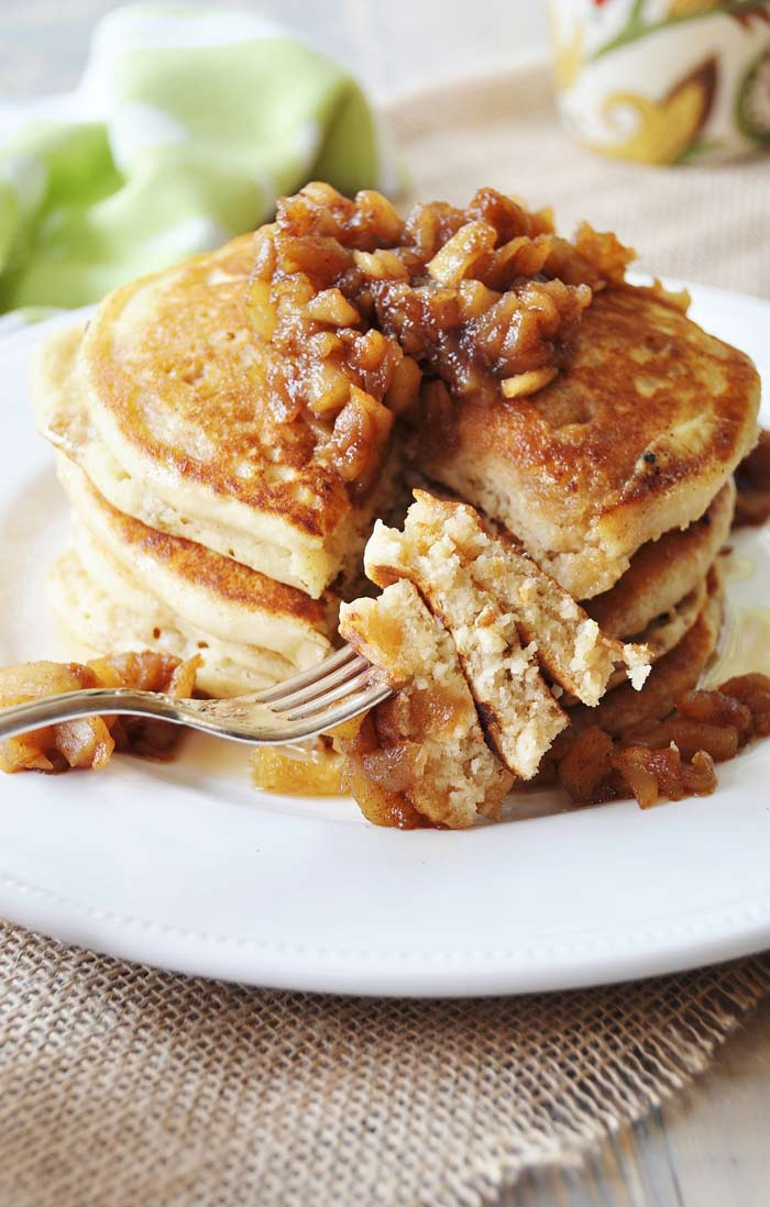 Old fashioned fluffy vegan pancakes with apple spice compote a forkful of old fashioned fluffy vegan pancakes smothered with apple spice compote ccuart Image collections