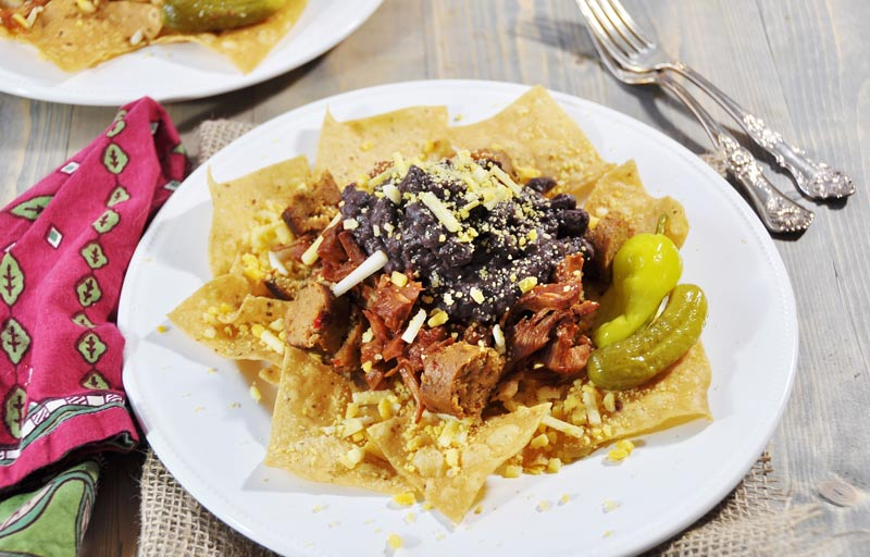 "Vegan ""Gut Pak,"" Inspired by Fixer Upper and Vitek's! This recipe is like a big plate of nachos, with Field Roast Italian sausage, Upton's BBQ jackfruit, Better Bean Cuban black beans, Go Veggie Mexican shreds, corn chips, and a dill pickle on the side. Quick, easy, and delicious! www.veganosity.com #fixerupper #FieldRoast #Upton's #GoVeggie, #BetterBean"