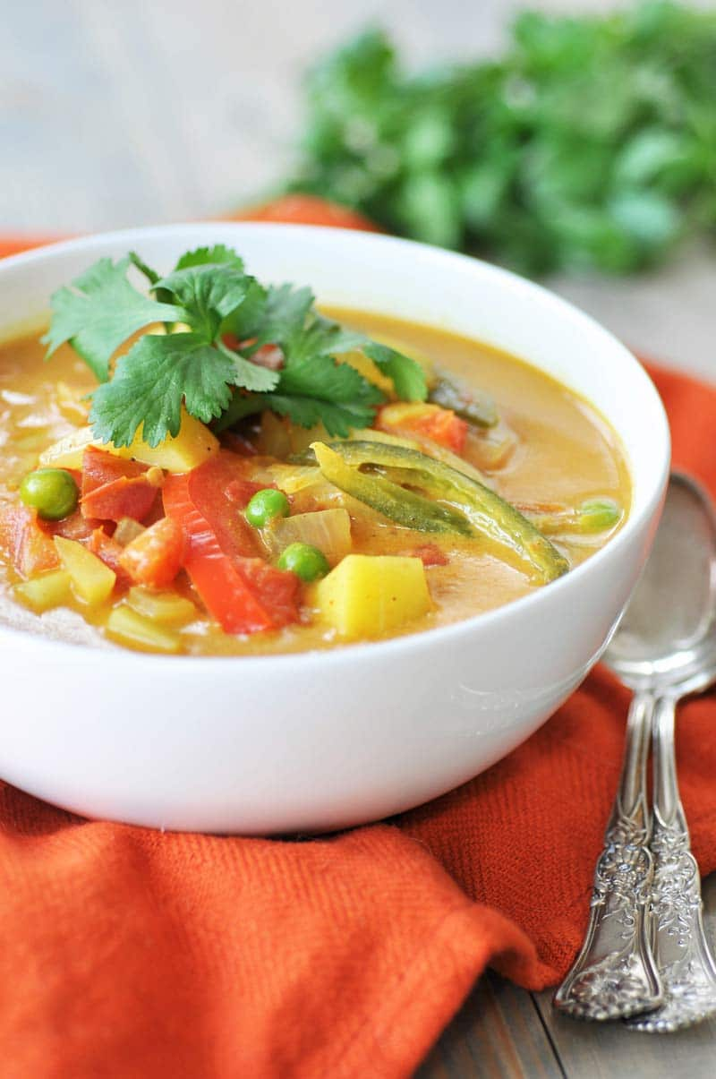Homemade Yellow Curry Potato Soup! This savory explosion of flavor is exactly what you need for dinner tonight. Potatoes, red bell peppers, serrano peppers, and peas make this a hearty and healthy recipe. One bowl will not be enough. www.veganosity.com
