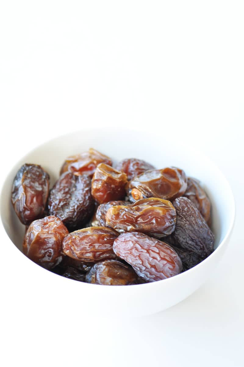 Dried dates in a white bowl