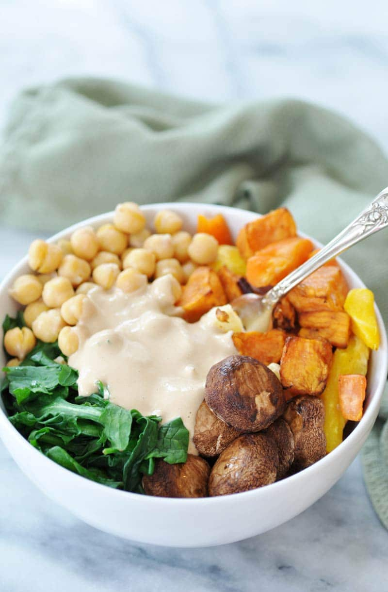 Root Vegetable Power Bowl & Roasted Garlic Tahini Dressing! This super bowl recipe is filled with the healthiest vegetables and pulses that you can eat. The dressing recipe is so rich, creamy, and flavorful. This is one of my favorites! www.veganosity.com