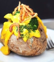 Vegan Cheddar & Broccoli Stuffed Baked Potato! Filled with our 6 Ingredient Vegan Cheddar Cheese Sauce and broccoli. The perfect easy weeknight meal.