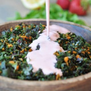 Crunchy red kale and carrots smothered in a creamy vegan strawberry sage dressing with a hint of mint. This salad recipe is perfect as a meal or a side. www.veganosity.com