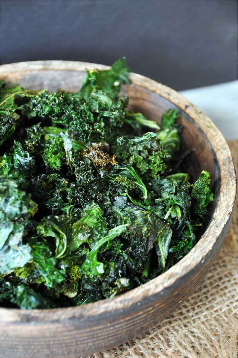 Make your own spicy kale chips at home. Find out how at www.veganosity ...