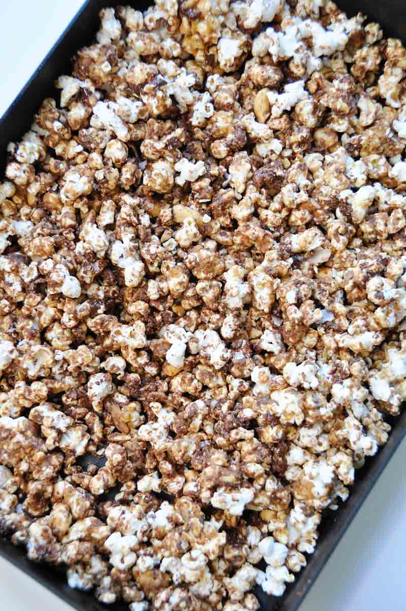 Air popped popcorn blended with peanut butter, chocolate, cashews, and coconut! The perfect snack! www.veganosity.com