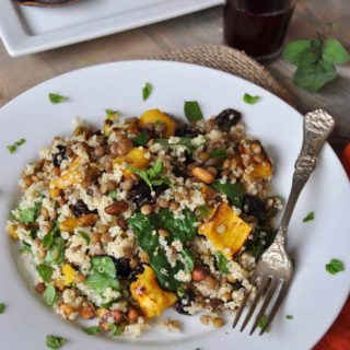 Warm Acorn Squash, Lentil, & Quinoa Salad with Sage Dressing
