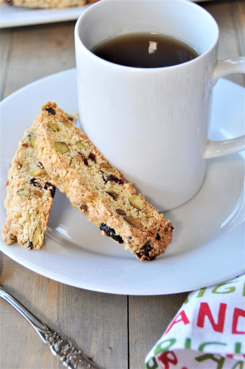 Aquafaba is the magic ingredient in this delicious and crispy vegan cranberry pistachio biscotti recipe. Dairy-free and egg-free! Perfect holiday cookies. www.veganosity.com