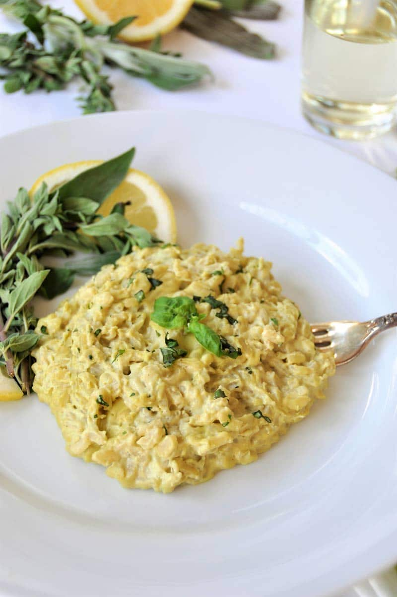 Creamy Vegan Risotto made with fresh herbs and a lemon cashew cream sauce.