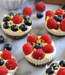 Vegan cashew cheesecake tarts with lemon, blueberries, and raspberries