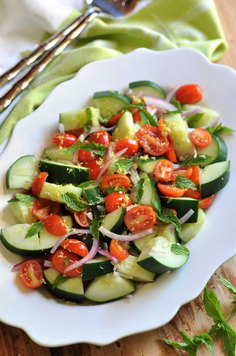 Simple, easy, and refreshing Cucumber, Tomato & Mint Salad, with a tangy lemon dressing! Oil-free!