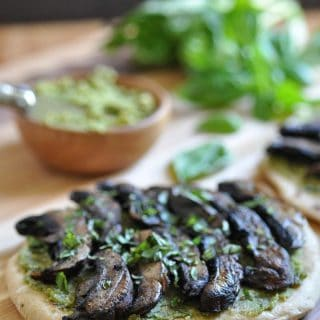 The perfect easy dinner or appetizer. Homemade flatbread with pesto & portobello mushrooms.