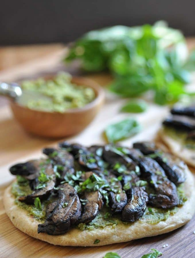 The perfect easy dinner or appetizer. Homemade flatbread with pesto & portobello mushrooms.