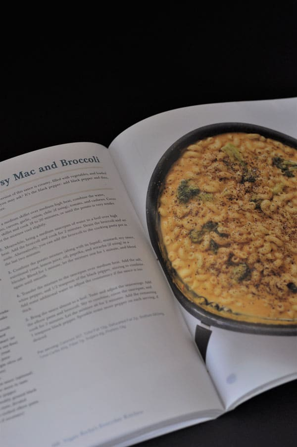Vegan Richa's Everyday Kitchen cookbook open to the Black Pepper Mac and Broccoli recipe with a picture of a pan of the mac and broccoli