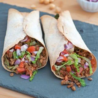 Two vegan Greek Burritos on a slate tray from Vegan Burgers and Burritos cookbook