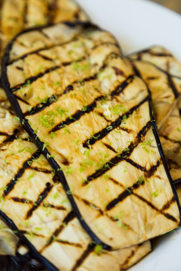 Grilled teriyaki eggplant closeup with lime zest