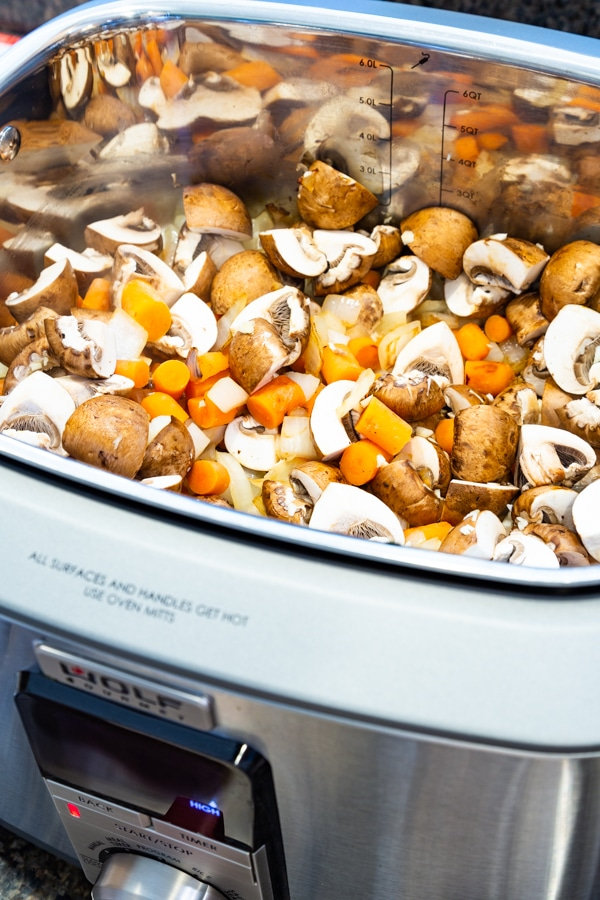 Cooking onions, carrots, and mushrooms in a Wolf Multi-Function Cooker