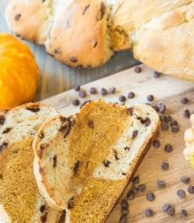 Pumpkin Chocolate Chip braided bread with chocolate chips on a wood board