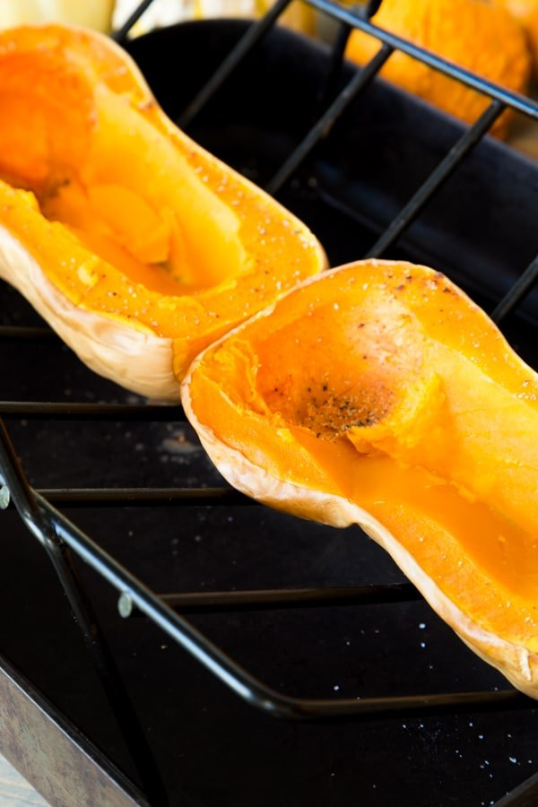 Roasted butternut squash with scooped out center on a roasting tray