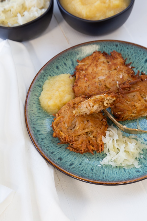 Potato pancakes inside with sauerkraut and applesauce