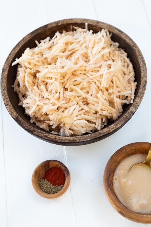 Spiced Potato pancake ingredients including shredded potato, spice blend, and vegan egg