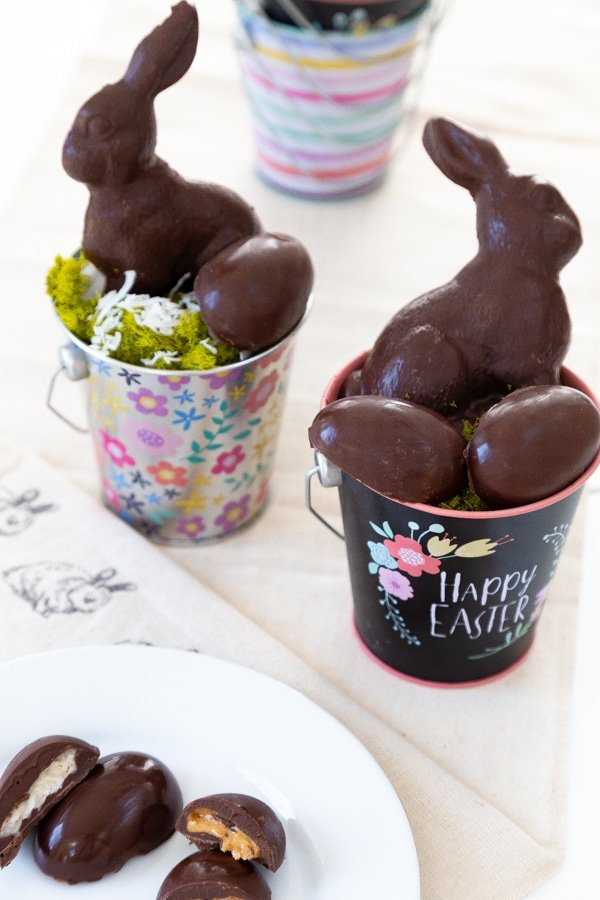 Two Easter baskets with chocolate eggs and rabbits