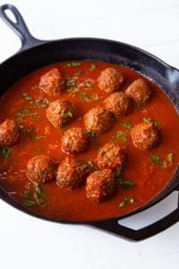 Veganosity's favorite brand of Meatballs in red sauce in an iron skillet
