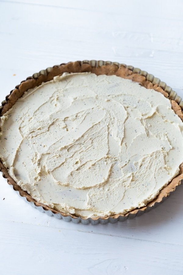 Cheese spread over a crust in a tart pan