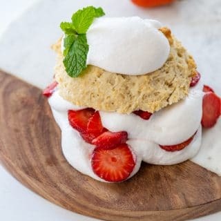 Strawberry shortcake on a marble and wood board.