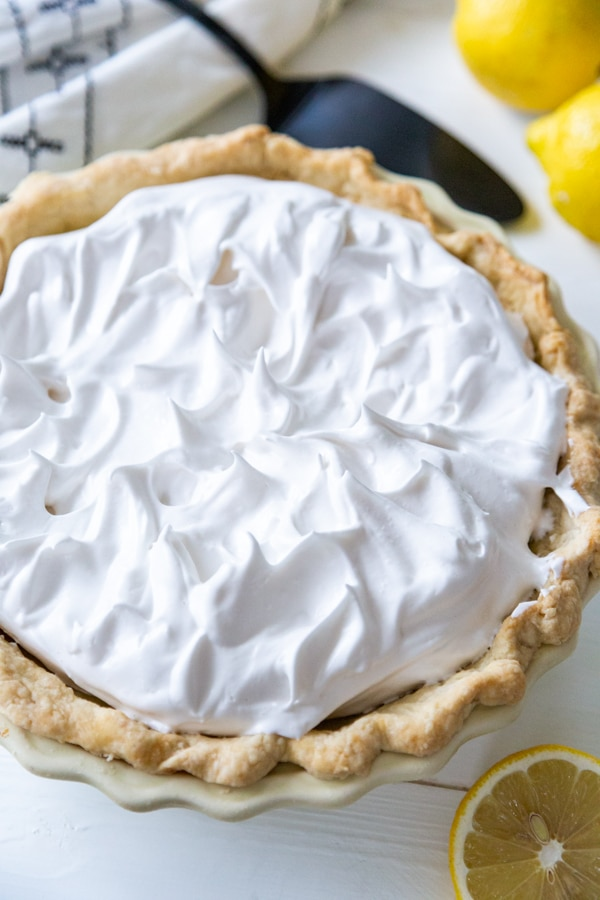 A lemon meringue pie before being baked.