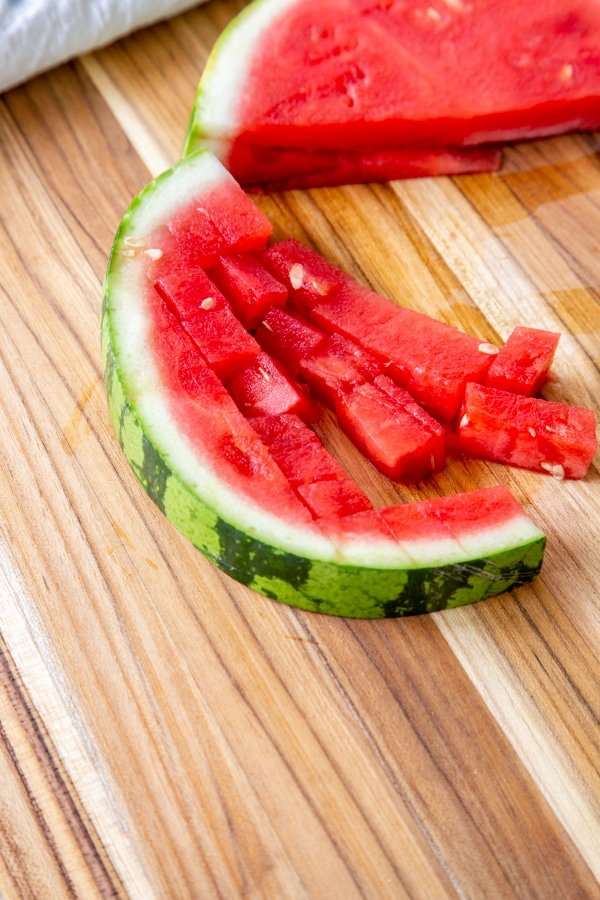 Half of a slice of watermelon cubed.