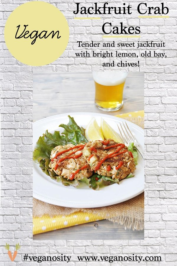 A Pinterest pin with a picture of jackfruit Crab Cakes on a white plate with a beer in the background.