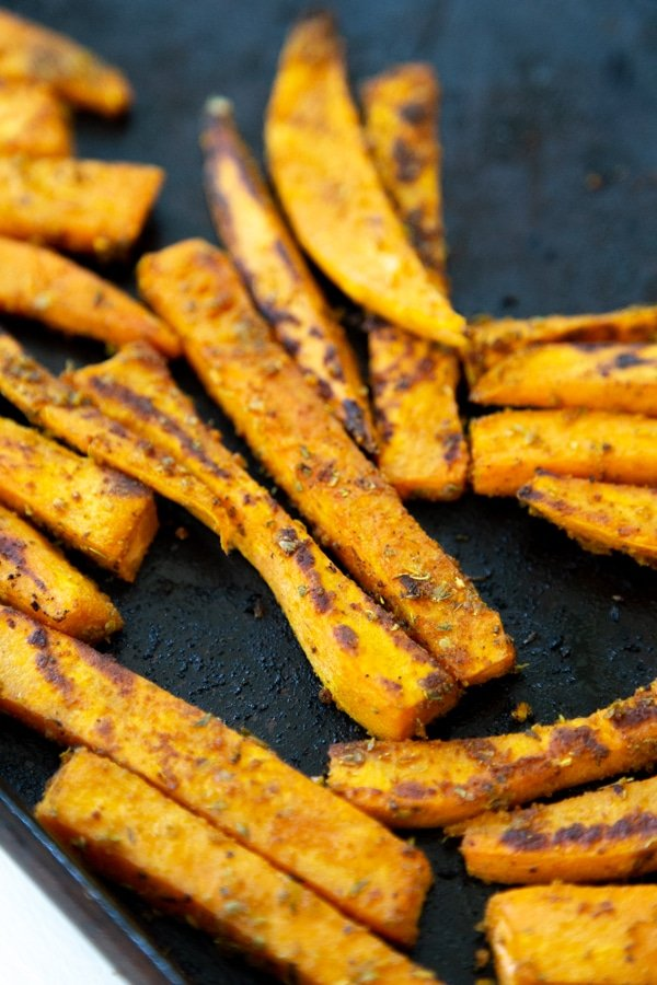 Crispy sweet potato fries on a baking sheet.