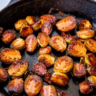 An iron skillet with roasted Brussels sprouts.