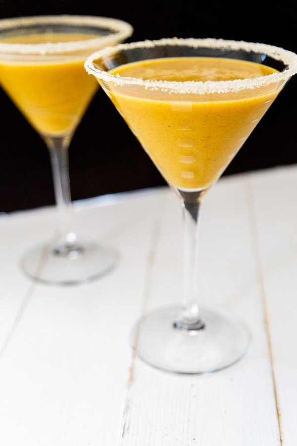 Two pumpkin martinis with a sugared rim.