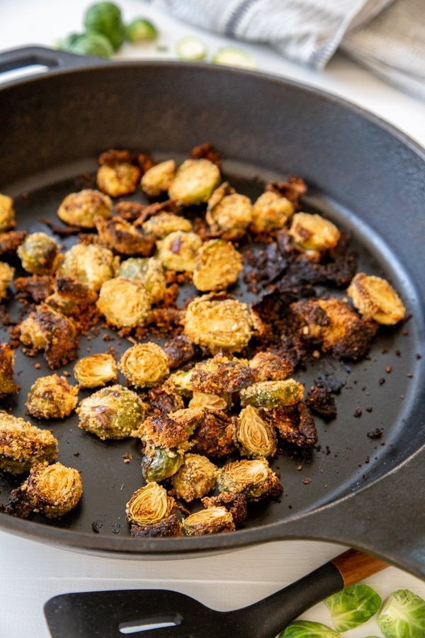 Breaded roasted Brussels sprouts in an Iron Skillet.