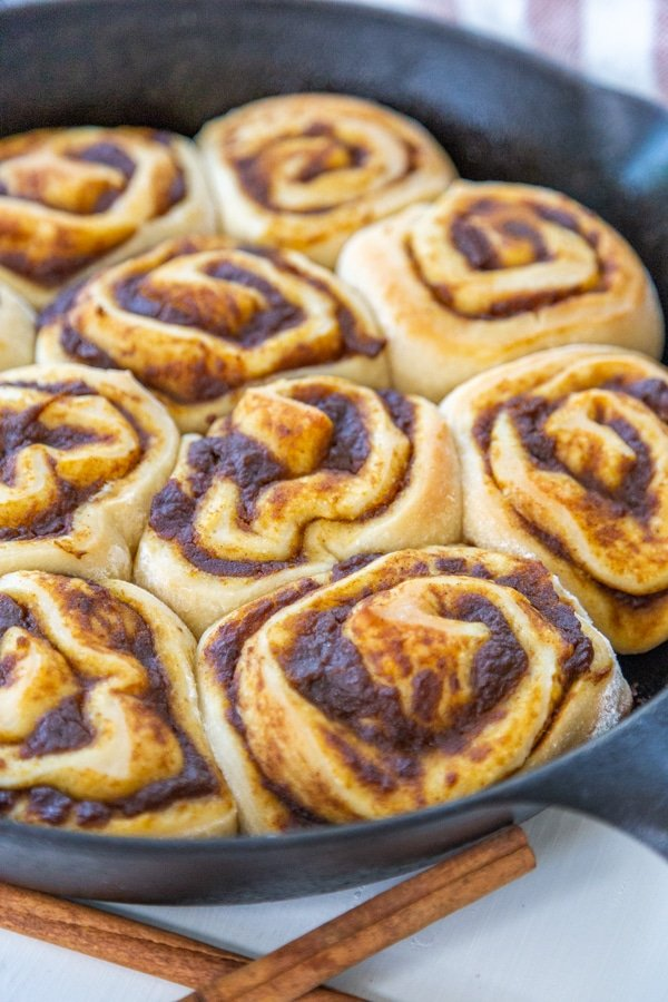 An iron skillet with freshly baked cinnamon rolls.