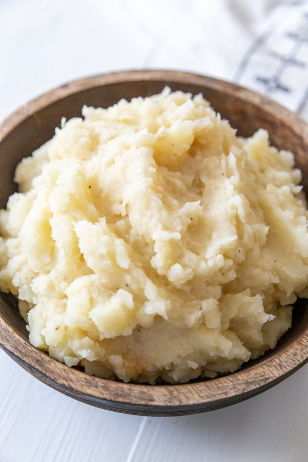 Mashed potatoes in a wooden bowl.