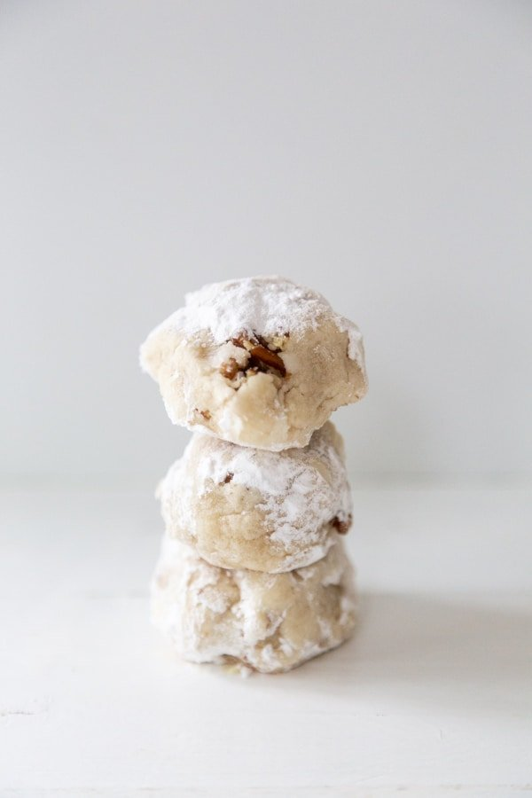 3 tea cake cookies stacked on top of each other on a white surface.