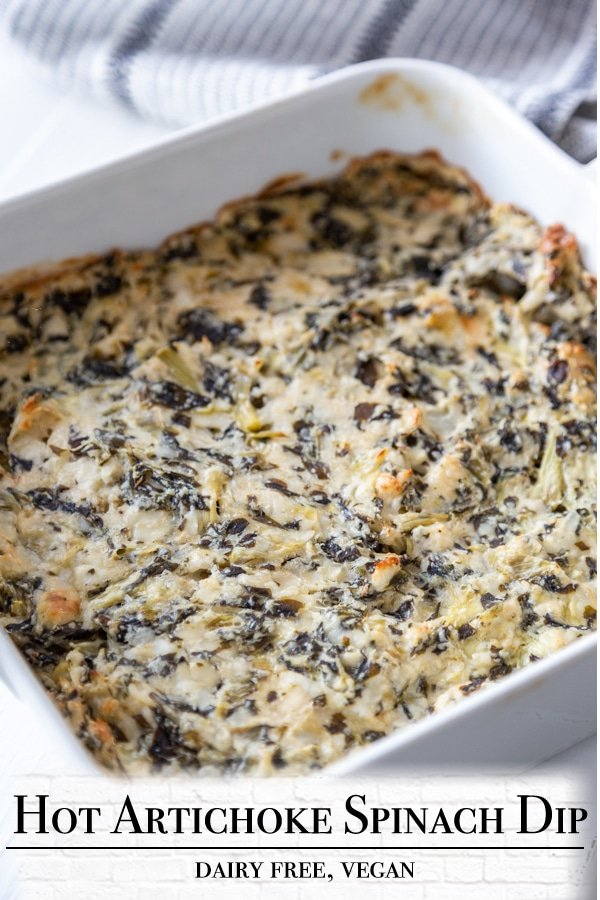 A Pinterest pin for vegan spinach artichoke dip with a picture of the dip in a white dish.