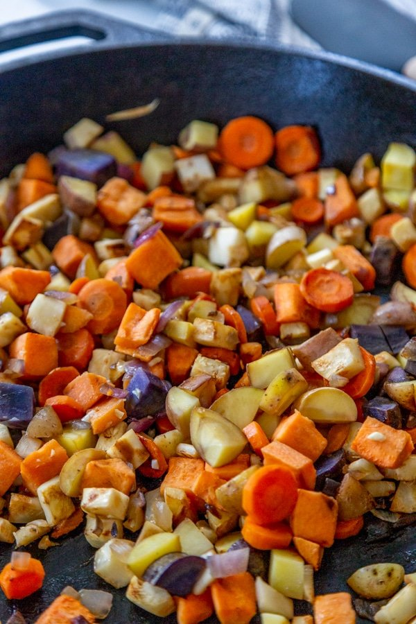 Cooked vegetables in an iron skillet.