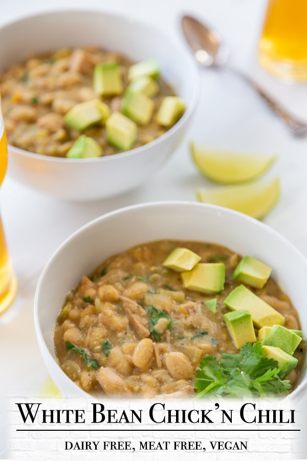 """A PInterest pin for vegan white bean """"chicken"""" chili with a picture of 2 bowls of the chili."""