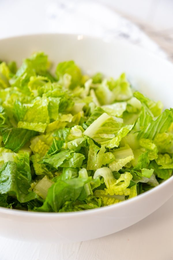 A large bowl of chopped lettuce.