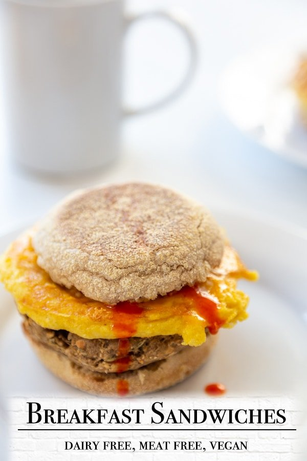 A PInterest pin for a vegan egg and sausage breakfast sandwich with a picture of the sandwich.