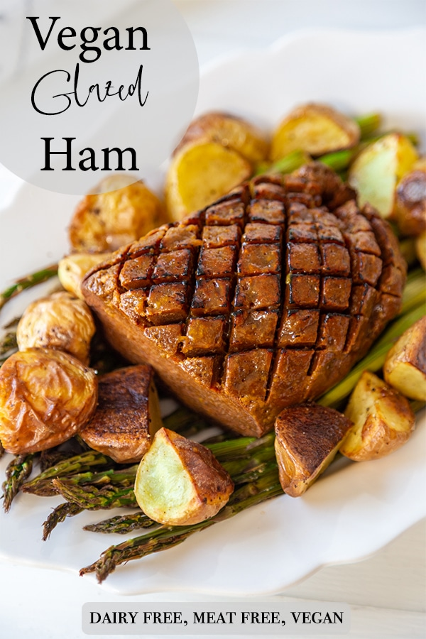 A Pinterest pin for vegan ham with a picture of the ham, asparagus, and potatoes.