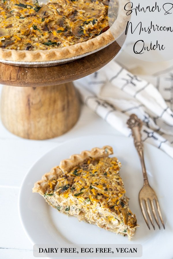 A Pinterest pin for vegan spinach and mushroom quiche with a picture of the quiche and a slice of it on a white plate.