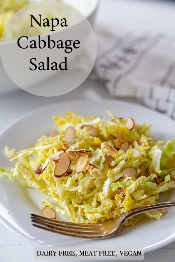 A Pinterest pin for Napa cabbage salad with a picture of the salad on a white plate with slivered almonds and a silver fork on the edge of the plate.