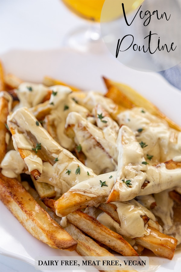 A Pinterest pin for vegan poutine with a picture of a white oval platter of the fries, gravy, and cheese sauce.